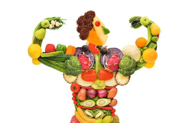 Muscle man made of fruits and veggies